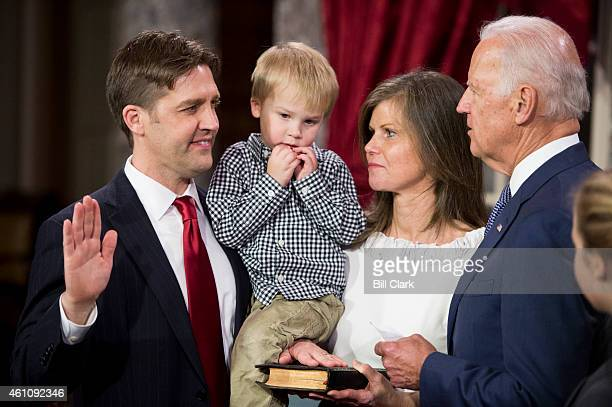 Sen Ben Sasse RNeb and Vice President Joe Biden participate in the reenactment swearingin ceremony in the Old Senate Chamber on Tuesday Jan 6 2015