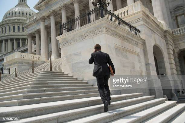 Sen Ben Sasse RNeb ascends the Senate steps before the last votes in the Senate that start recess on August 3 2017