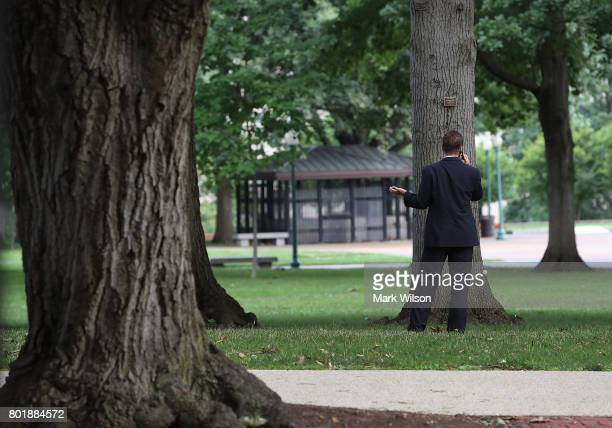 Sen Ben Sasse talks on his phone in Upper Senate Park on Capitol Hill June 27 2017 in Washington DC It is unknown whether Senate Republicans will...