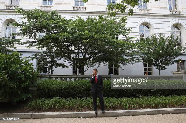 Sen Ben Sasse talks on his phone outside of the Russell Senate Office building on Capitol Hill June 27 2017 in Washington DC It is unknown whether...