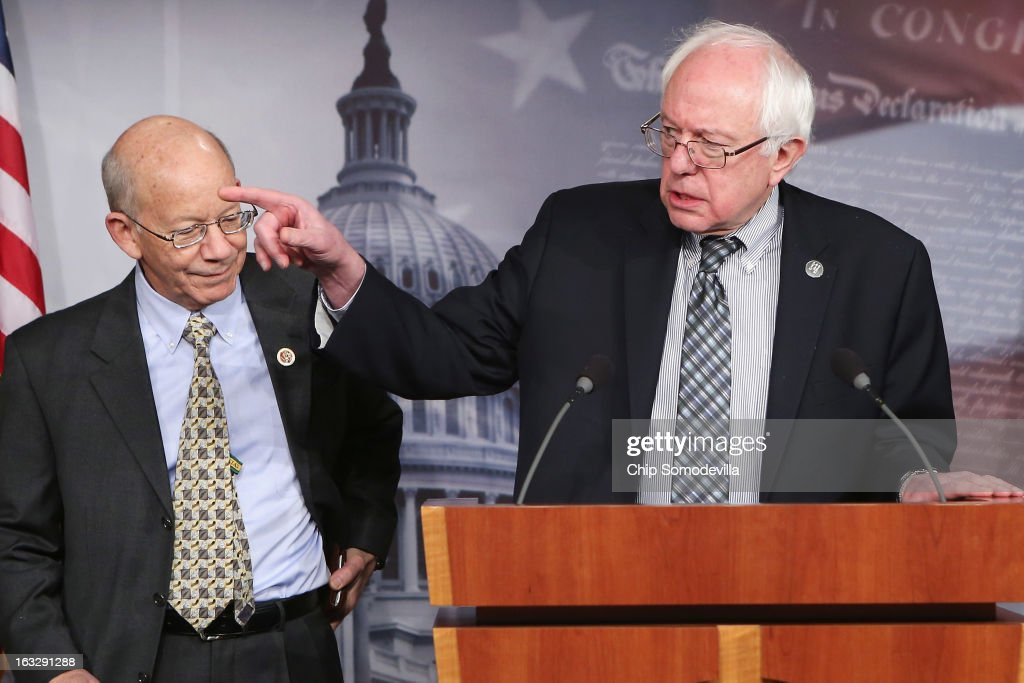 U.S. Sen. <a gi-track='captionPersonalityLinkClicked' href=/galleries/search?phrase=Bernie+Sanders&family=editorial&specificpeople=2908340 ng-click='$event.stopPropagation()'>Bernie Sanders</a> (I-VT) (R) and U.S. Rep. Peter DeFazio (D-OR) hold a news conference to announce their proposed legislation to strengthen Social Security March 7, 2013 in Washington, DC. Sanders and DeFazio are sponsoring the 'Keepping Our Social Security Promises Act,' which they say will increase payroll taxes on the wealthest and bolster Social Security without raising the retirement age or lowering benefits.