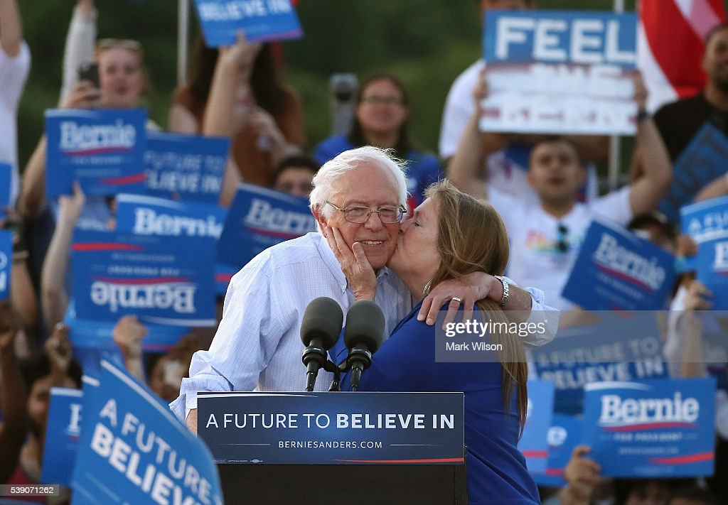 Sen. Bernie Sanders (I-VT), gets a kiss from his wife Jane O'Meara Sanders after speaking at a campaign rally at Robert F. Kennedy Memorial Stadium June 9, 2016 in Washington, DC. After a meeting with President Barack Obama earlier at the White House, Sanders said he will work with Hillary Clinton to beat Donald Trump in the presidential election.