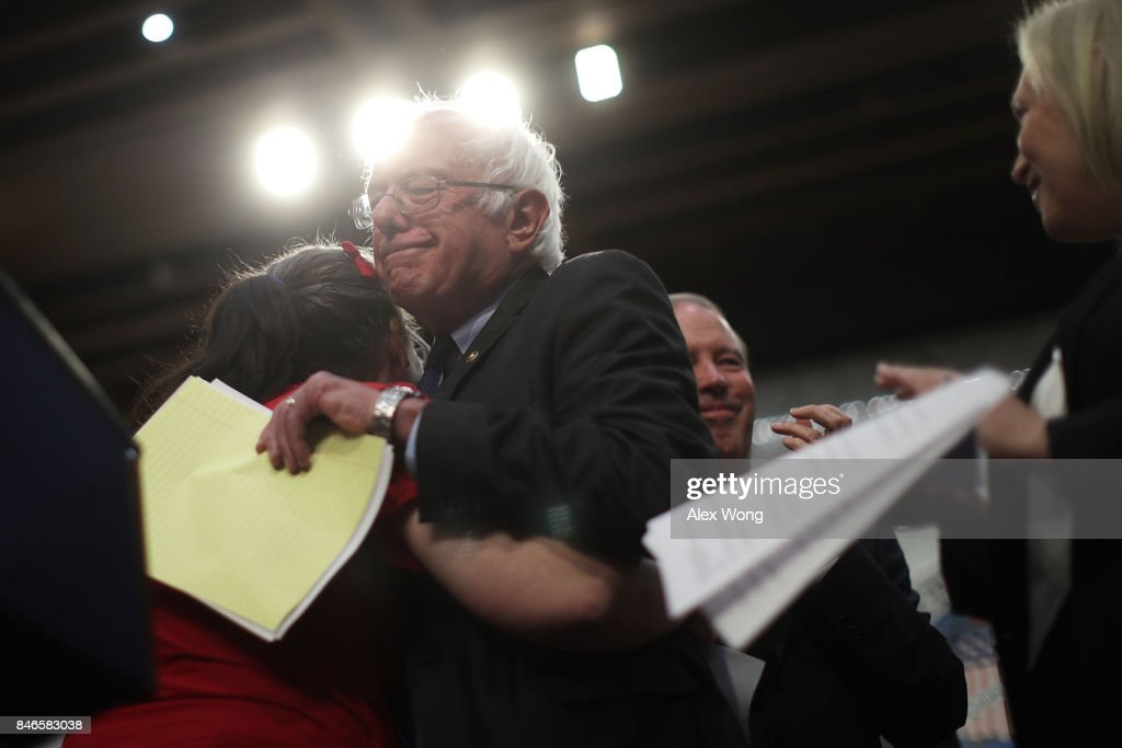 U.S. Sen. Bernie Sanders (I-VT) hugs a supporter during an event on health care September 13, 2017 on Capitol Hill in Washington, DC. Sen. Sanders held an event to introduce the Medicare for All Act of 2017.