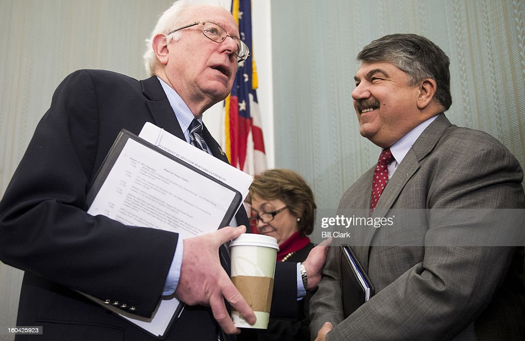Sen. Bernie Sanders, I-Vt., left, speaks with AFL-CIO president Richard Trumka before the start of the news conference to oppose the chained Consumer Price Index to cut benefits for Social Security and disabled veterans on Thursday, Jan. 31, 2013.