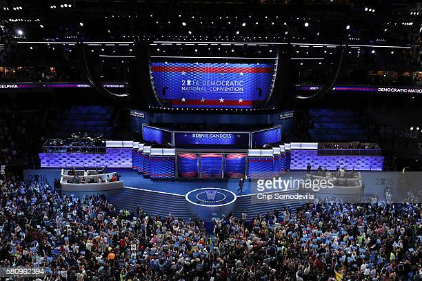 Sen Bernie Sanders waves to the crowd after delivering remarks on the first day of the Democratic National Convention at the Wells Fargo Center July...