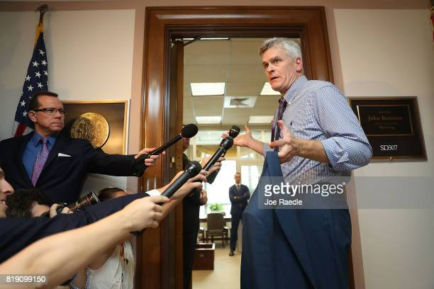 Sen Bill Cassidy speaks to reporters as he arrives to attend a healthcare bill meeting with fellow Republican senators at the Dirksen Senate Office...