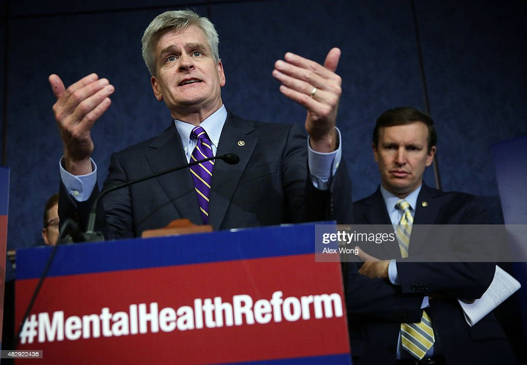 U.S. Sen. <a gi-track='captionPersonalityLinkClicked' href=/galleries/search?phrase=Bill+Cassidy+-+Pol%C3%ADtico&family=editorial&specificpeople=13707095 ng-click='$event.stopPropagation()'>Bill Cassidy</a> (R-LA) (L) speaks as Sen. <a gi-track='captionPersonalityLinkClicked' href=/galleries/search?phrase=Chris+Murphy+-+Pol%C3%ADtico&family=editorial&specificpeople=12884903 ng-click='$event.stopPropagation()'>Chris Murphy</a> (D-CT) (R) listens during a news conference August 4, 2015 on Capitol Hill in Washington, DC. The lawmakers held the news conference to discuss the Mental Health Reform Act of 2015.