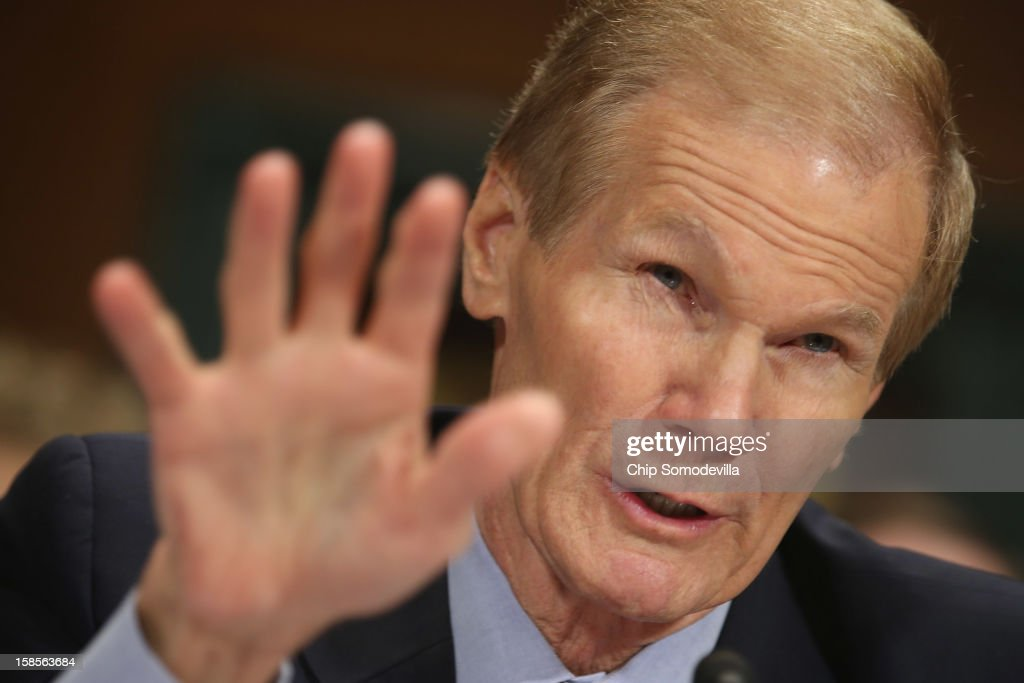 U.S. Sen. <a gi-track='captionPersonalityLinkClicked' href=/galleries/search?phrase=Bill+Nelson+-+Florida+Senator&family=editorial&specificpeople=13672972 ng-click='$event.stopPropagation()'>Bill Nelson</a> (D-FL) testifies during a Senate Judiciary Committee hearing on voting rights at the Dirksen Senate Office Building on Capitol Hill December 19, 2012 in Washington, DC. According to the committee, the hearing focused on Americans' access to the voting booth 'and the continuing need for protections against efforts to limit or suppress voting.'