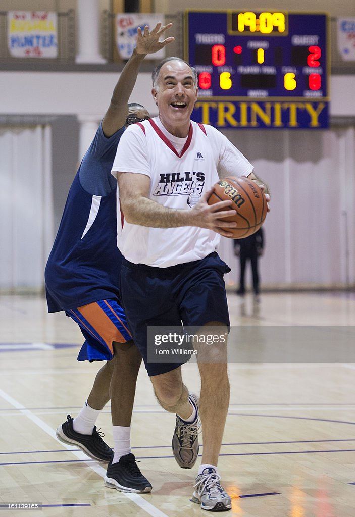 Sen. Bob Casey, D-Pa., drives to the basket during the Home Court 26th annual charity basketball game at Trinity University, which pits members of Congress against Georgetown Law Center faculty. The game, that Congress won 44-34, benefits the Washington Legal Clinic for the Homeless.