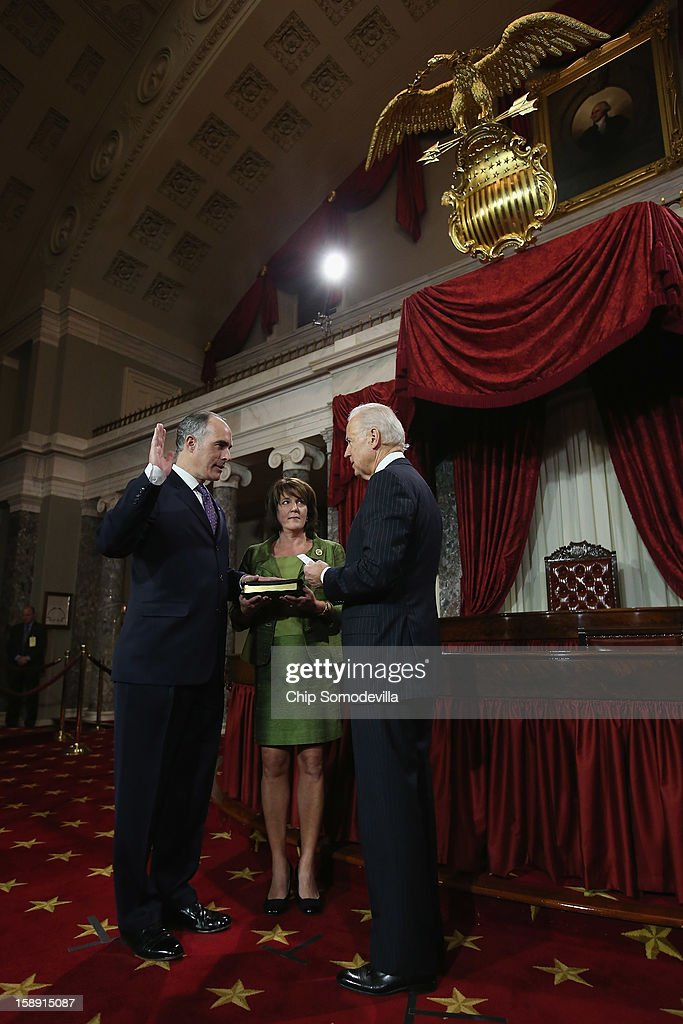 U.S. Sen. Bob Casey, Jr. (D-PA) (L) participates in a reenacted swearing-in with his wife Terese Foppiano Casey and U.S. Vice President Joe Biden in the Old Senate Chamber at the U.S. Capitol January 3, 2013 in Washington, DC. Biden swore in the newly-elected and re-elected senators earlier in the day on the floor of the current Senate chamber.