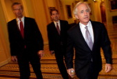 Sen Bob Corker and Sen John Thune arrive for a meeting of Senate Republicans on a solution for the pending budget and debt limit impasse at the US...