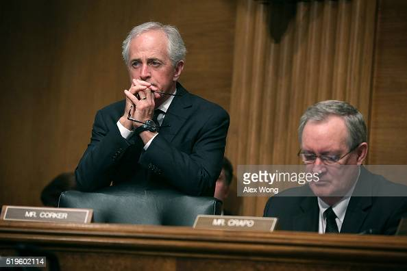 S Sen Bob Corker and Sen Michael Crapo listen during a hearing before the Senate Banking Housing and Urban Affairs Committee April 7 2016 on Capitol...