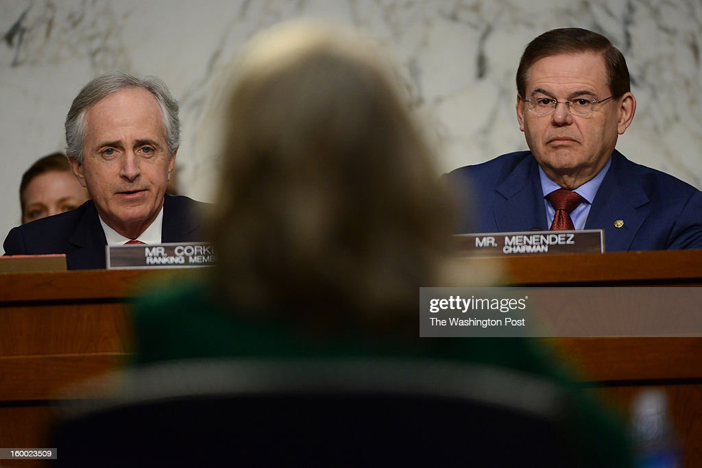 Sen. Bob Corker (R-TN) (L) and Sen. Robert Mendez (D-NJ) listen to testimony from Secretary of State Hillary Clinton on the Benghazi attack in the Senate Foreign Relations Committee hearing in Washington, DC on January 23, 2013. The Secretary has been unable to testify recently due to recent health issues. Now that she's recovered, her testimony may shed light on what happened regarding security measures to protect the U.S. Consulate was fatally attacked in Benghazi, Libya. The US Ambassador to Libya and three other americans were killed in the attack last September 11th.