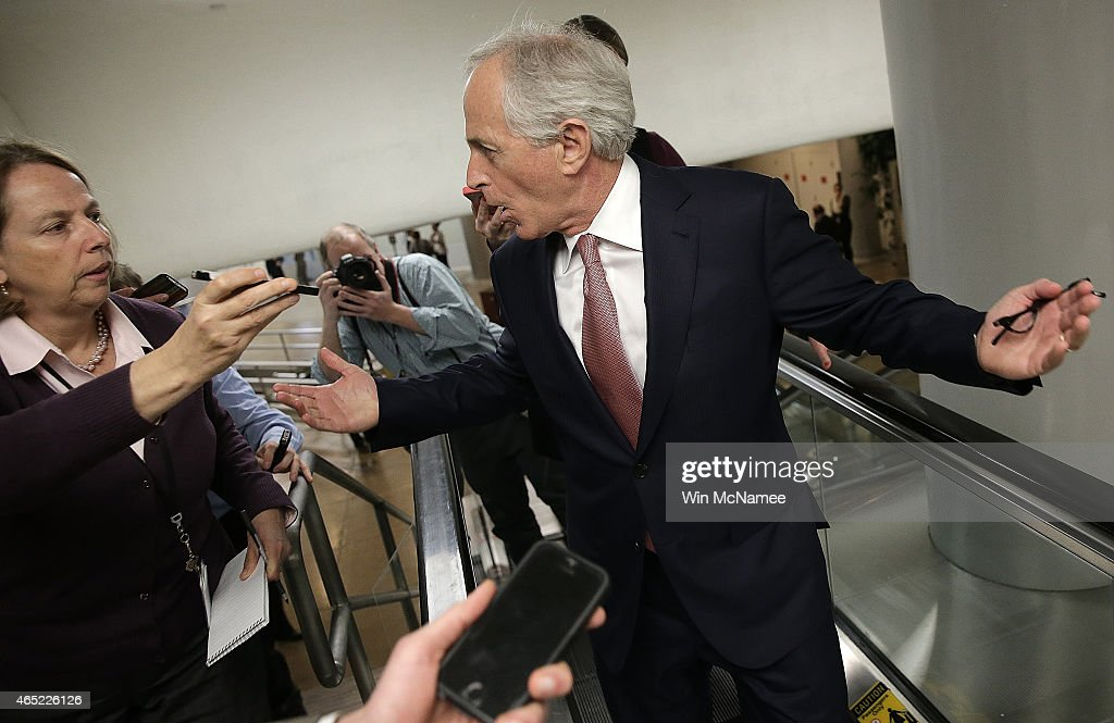Sen. Bob Corker (R-AL) answers questions from reporters as he walks to the Senate chamber to vote on an attempt to override U.S. President Barack Obama's veto of the Keystone XL Pipeline legislation March 4, 2015 in Washington, DC. The Senate vote on overriding the veto failed to pass by the necessary two thirds majority by a count of 62-37.
