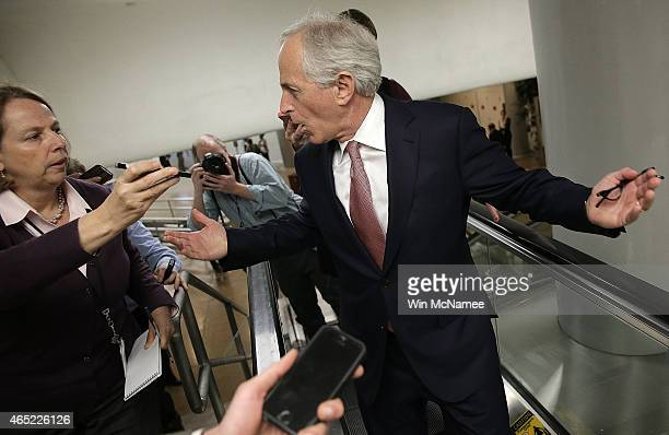Sen Bob Corker answers questions from reporters as he walks to the Senate chamber to vote on an attempt to override US President Barack Obama's veto...