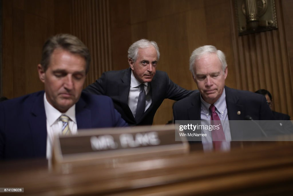 Sen. Bob Corker (C) (R-TN), chairman of the Senate Foreign Relations Committee, confers with Sen. Ron Johnson (R) (R-WI) during a committee hearing November 14, 2017 in Washington, DC. The committee heard testimony on the 'Authority to Order the Use of Nuclear Weapons.' Also pictured is Sen. Jeff Flake (R) (R-AZ).