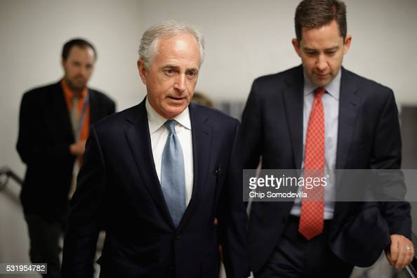 Sen Bob Corker heads for the weekly Republican policy luncheon at the US Capitol May 17 2016 in Washington DC Leaders from both sides of the aisle...