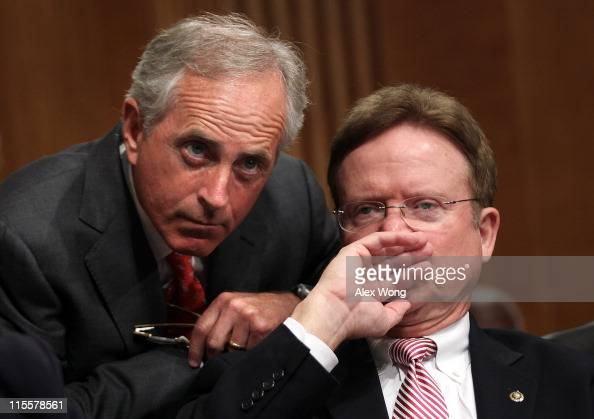 S Sen Bob Corker listens to Sen Jim Webb during a confirmation hearing before the Senate Foreign Relations Committee for Ambassador Ryan Crocker June...