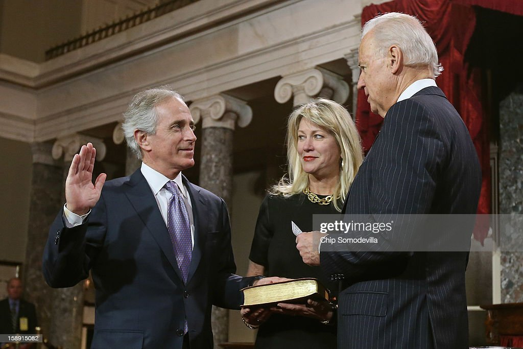 U.S. Sen. <a gi-track='captionPersonalityLinkClicked' href=/galleries/search?phrase=Bob+Corker&family=editorial&specificpeople=3986296 ng-click='$event.stopPropagation()'>Bob Corker</a> (R-TN) participates in a reenacted swearing-in with his wife Elizabeth Corker and U.S. Vice President Joe Biden in the Old Senate Chamber at the U.S. Capitol January 3, 2013 in Washington, DC. Biden swore in the newly-elected and re-elected senators earlier in the day on the floor of the current Senate chamber.