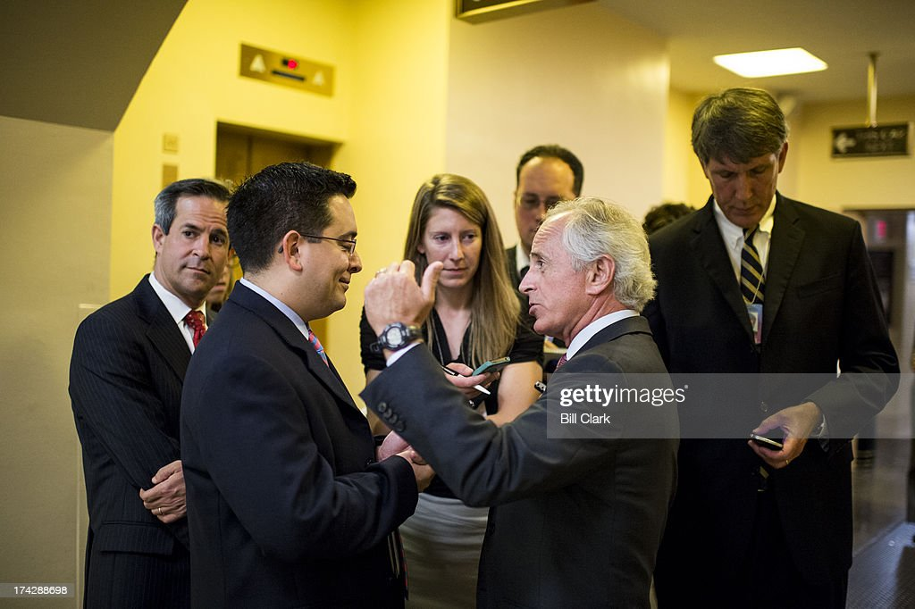 Sen. Bob Corker, R-Tenn., speaks with reporters as he arrives in the Capitol for a vote on Tuesday, July 23, 2013.