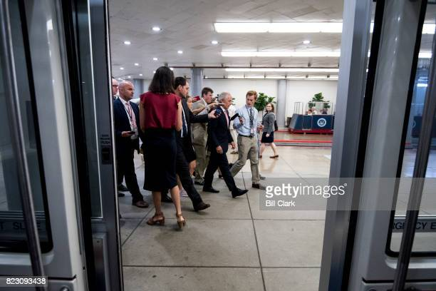 Sen Bob Corker RTenn speaks with reporters as he walks through the Senate subway on Tuesday July 25 2017