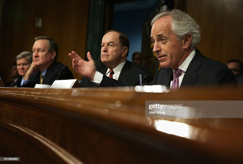 U.S. Sen. <a gi-track='captionPersonalityLinkClicked' href=/galleries/search?phrase=Bob+Corker&family=editorial&specificpeople=3986296 ng-click='$event.stopPropagation()'>Bob Corker</a> (R-TN) speaks as Sen. <a gi-track='captionPersonalityLinkClicked' href=/galleries/search?phrase=Richard+Shelby&family=editorial&specificpeople=529578 ng-click='$event.stopPropagation()'>Richard Shelby</a> (R-AL), committee ranking member Sen. Mike Crapo (R-ID) and committee chairman Sen. Tim Johnson (D-SD) listen during a confirmation hearing for Nominee for the Federal Reserve Board Chairman Janet Yellen (3rd L) before Senate Banking, Housing and Urban Affairs Committee November 14, 2013 on Capitol Hill in Washington, DC. Yellen will be the first woman to head the Federal Reserve if confirmed by the Senate and will succeed Ben Bernanke.