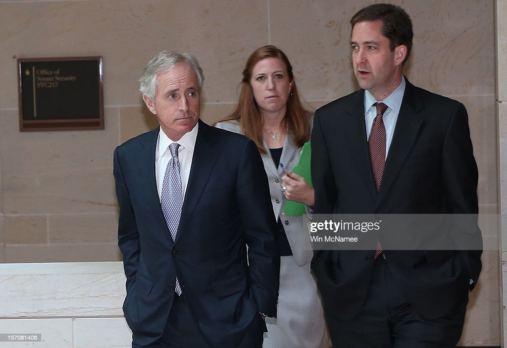 Sen. Bob Corker (R-TN) (L) speaks to reporters after meeting with U.S. Ambassador to the United Nations, Susan Rice, at the U.S. Capitol after meeting with members of the U.S. Senate November 28, 2012 in Washington, DC. Rice has been meeting with members of Congress over the past two days to explain her position on remarks made regarding the attack on the U.S. consulate in Benghazi, Libya.