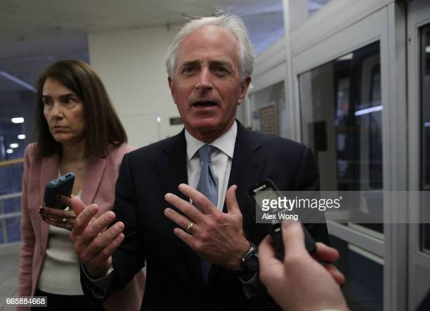 S Sen Bob Corker talks to members of the media as he leaves after a closed briefing on the airstrikes against Syria by Chairman of the Joint Chiefs...