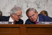 S Sen Bob Corker talks with Chairman Robert Menendez during a Senate Foreign Relations Committee vote on a resolution on Syria on Capitol Hill...