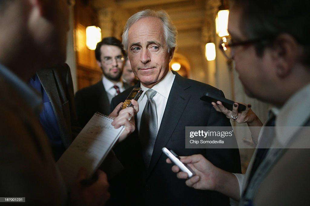 Sen. Bob Corker (R-TN) talks with reporters before attending the weekly Republican Senate caucus policy luncheon at the U.S. Capitol November 5, 2013 in Washington, DC. The Senate overcame a procedural hurdle Monday to move closer to passage of the Employment Non-Discrimination Act of 2013, which would outlaw workplace discrimination based on sexual orientation and gender identity.
