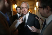 Sen Bob Corker talks with reporters before attending the weekly Republican Senate caucus policy luncheon at the US Capitol November 5 2013 in...