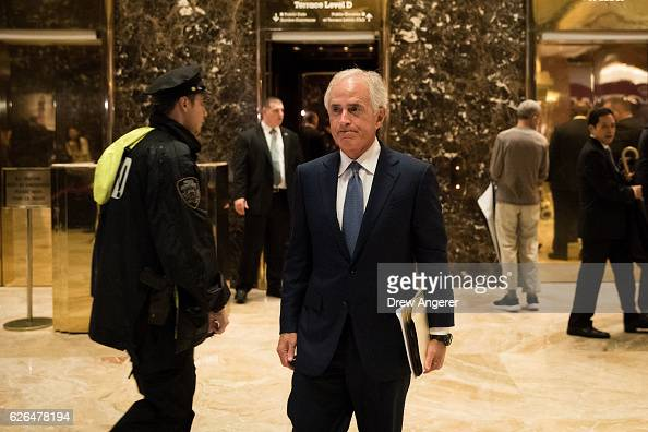 Sen Bob Corker walks to speak to the media at Trump Tower November 29 2016 in New York City Presidentelect Donald Trump and his transition team are...
