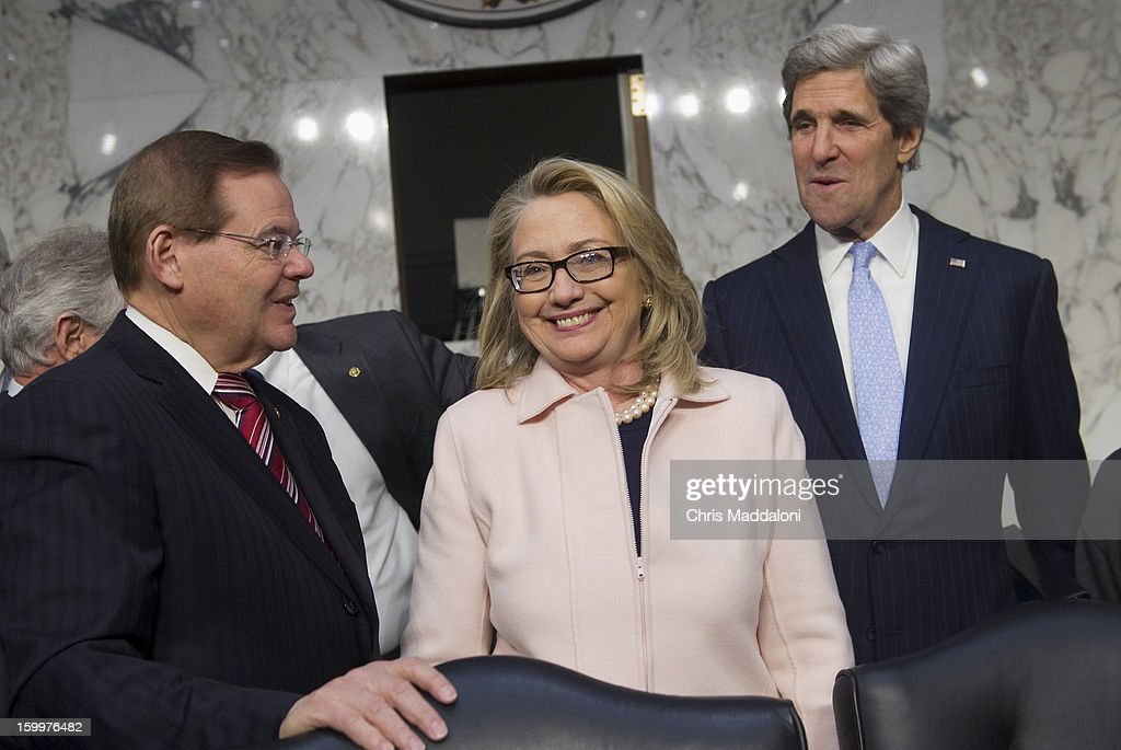 Sen. Bob Menendez, D-N.J., greets Secretary of State Hillary Clinton and Senate Foreign Relations Chairman Sen. John Kerry, D-Mass., President Barack Obama's nominee to become secretary of state, at Kerry's confirmation hearing before the Senate Foreign Relations committee. Kerry, if confirmed, would replace Clinton as Secretary.
