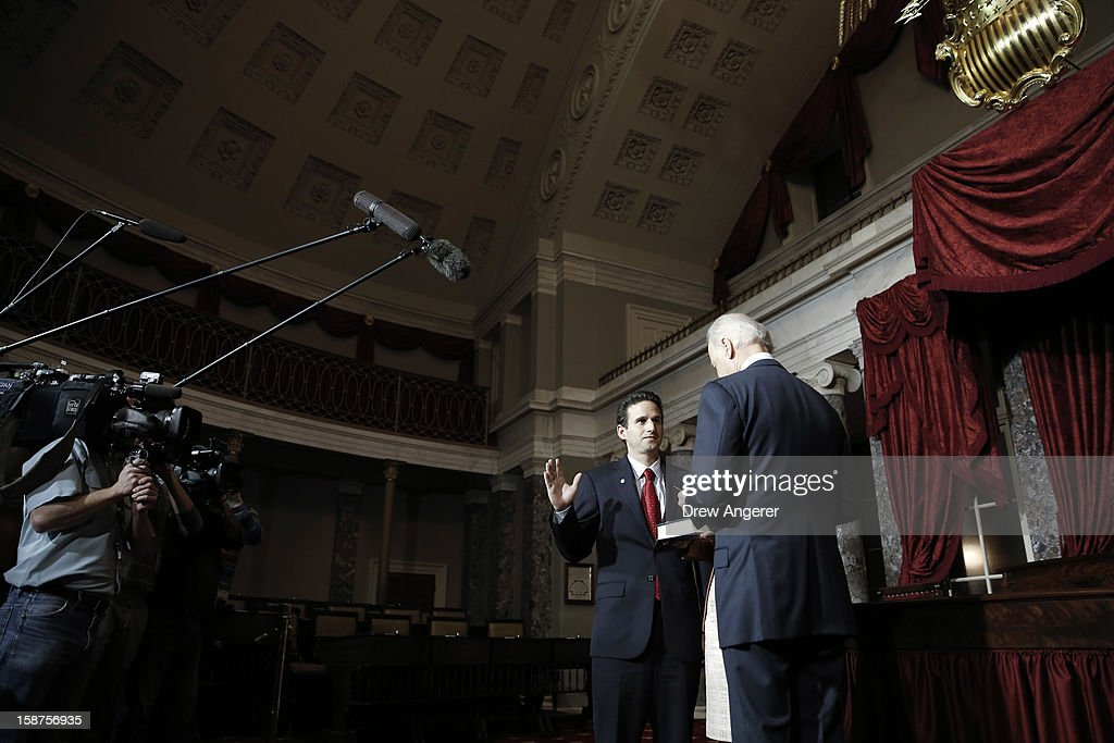 Sen. Brian Schatz (D-HI) (L) participates in a ceremonial swearing in event with Vice President Joe Biden, in the Old Senate Chamber on Capitol Hill, on December 27, 2012 in Washington, DC. Schatz is filling the late Sen. Daniel Inouye's (D-HI) seat in the Senate.