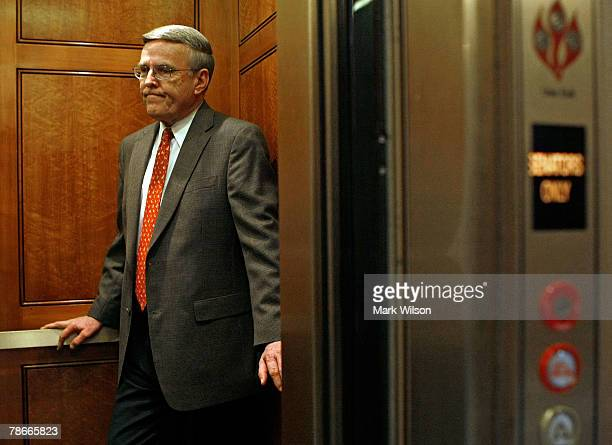 Sen Byron Dorgan gets in an elevator after opening then minutes later closing the US Senate at the US Capitol building December 28 2007 in Washington...
