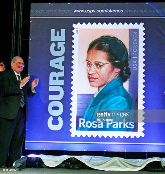 S Sen Carl Levin applauds during the unvieling of the Rosa Parks commemorative stamp issued by the US Postal Service February 4 2013 at The Henry...