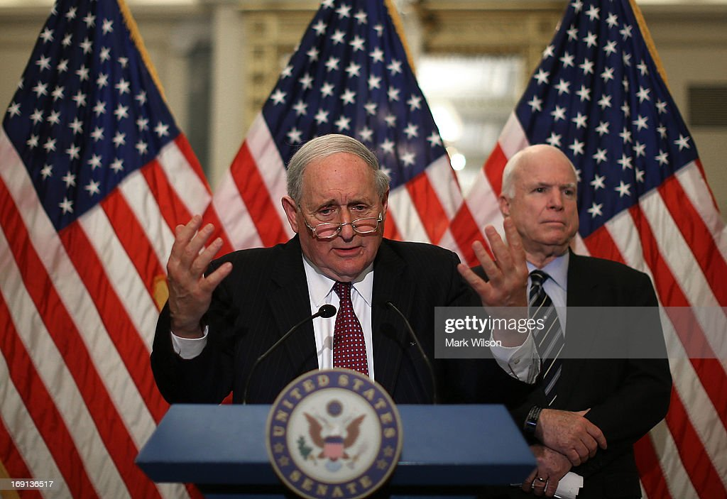 U.S. Sen. <a gi-track='captionPersonalityLinkClicked' href=/galleries/search?phrase=Carl+Levin&family=editorial&specificpeople=208878 ng-click='$event.stopPropagation()'>Carl Levin</a> (D-MI) (L), Chairman of the Senate Investigations Subcommittee, and U.S. Sen. <a gi-track='captionPersonalityLinkClicked' href=/galleries/search?phrase=John+McCain&family=editorial&specificpeople=125177 ng-click='$event.stopPropagation()'>John McCain</a> (R-AZ) speak to reporters during a briefing on Capitol Hill, May 20, 2013 in Washington, DC. The briefing was held in advance of Tuesday's hearing on offshore profit shifting and the United States tax code.