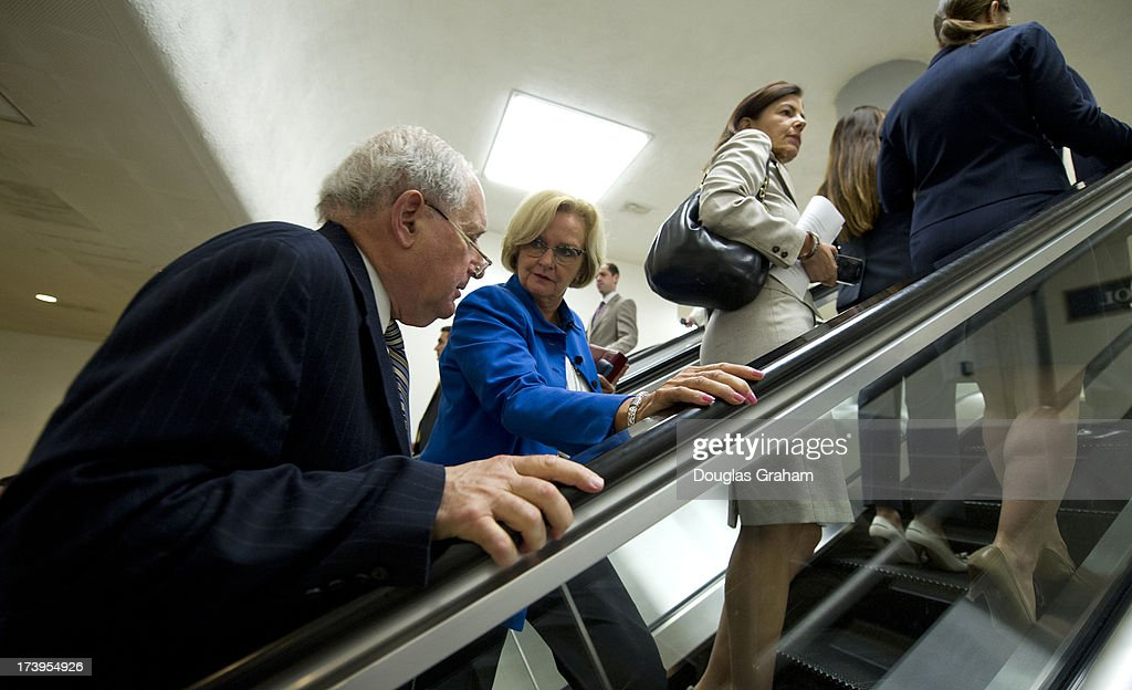 Sen. Carl Levin, D-MI., and Sen. Claire McCaskill, D-MO., talk as they make there way to the Senate policy luncheons through the Senate subway in the U.S. Capitol on July 18, 2013.