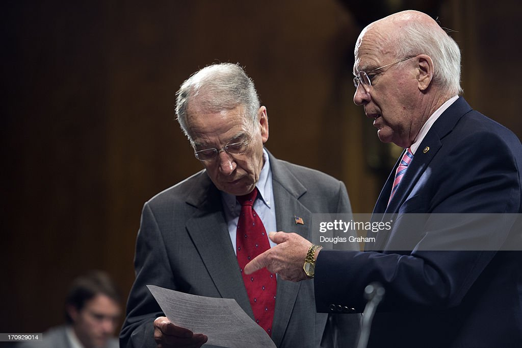 Sen. Charles Grassley, R-IA., talks with Chairman Patrick Leahey, D-VT., before the start of the Senate Judiciary committee business meeting to consider S.162, to re-authorize and improve the Mentally Ill Offender Treatment and Crime Reduction Act of 2004 on June 20, 2013.