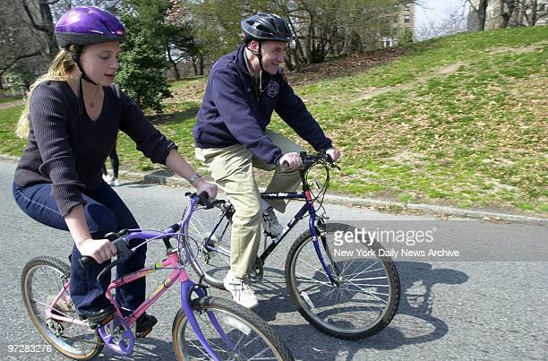 Sen Charles Schumer and Amber Maltabie begin their bicycle tour of Brooklyn together from Prospect Park Maltabie was the highest bidder for the...