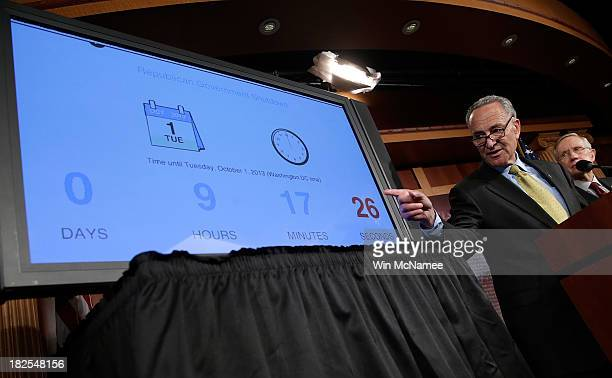 Sen Charles Schumer and Sen Harry Reid speak at a press conference with a 'countdown clock' after the Senate voted to table House legislation to...