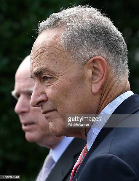 S Sen Charles Schumer and Sen John McCain answer questions from members of the press at the White House following a meeting with US President Barack...