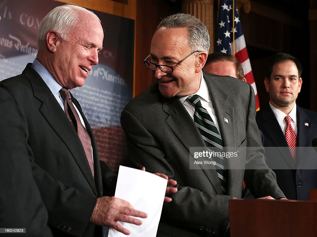 U.S. Sen. <a gi-track='captionPersonalityLinkClicked' href=/galleries/search?phrase=Charles+Schumer&family=editorial&specificpeople=171249 ng-click='$event.stopPropagation()'>Charles Schumer</a> (D-NY) (2nd L) and Sen. <a gi-track='captionPersonalityLinkClicked' href=/galleries/search?phrase=John+McCain&family=editorial&specificpeople=125177 ng-click='$event.stopPropagation()'>John McCain</a> (R-AZ) (L) share a moment as Sen. Marco Rubio (R-FL) (R) looks on during a news conference on a comprehensive immigration reform framework January 28, 2013 on Capitol Hill in Washington, DC. A group of bipartisan senate members have reached to a deal of outlines to reform the national immigration laws.