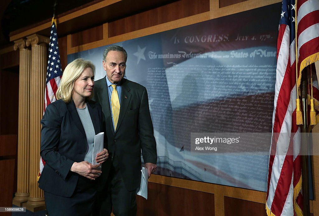 U.S. Sen. Charles Schumer (D-NY) (R) and Sen. Kirsten Gillibrand (D-NY) (L) leave after a news conference January 4, 2013 on Capitol Hill in Washington, DC. Schumer and Gillibrand spoke on the passing of a small portion of the superstorm Sandy relief bill.