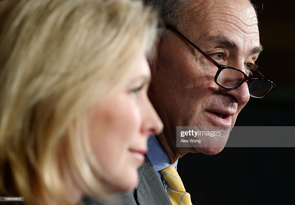 U.S. Sen. <a gi-track='captionPersonalityLinkClicked' href=/galleries/search?phrase=Charles+Schumer&family=editorial&specificpeople=171249 ng-click='$event.stopPropagation()'>Charles Schumer</a> (D-NY) (R) and Sen. <a gi-track='captionPersonalityLinkClicked' href=/galleries/search?phrase=Kirsten+Gillibrand&family=editorial&specificpeople=4099377 ng-click='$event.stopPropagation()'>Kirsten Gillibrand</a> (D-NY) (L) speak to the media during a news conference January 4, 2013 on Capitol Hill in Washington, DC. Schumer and Gillibrand spoke on the passing of a small portion of the superstorm Sandy relief bill.