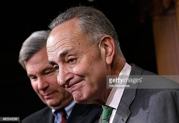 S Sen Charles Schumer and Sen Sheldon Whitehouse speak during a press conference at the US Capitol April 2 2014 in Washington DC Schumer and...