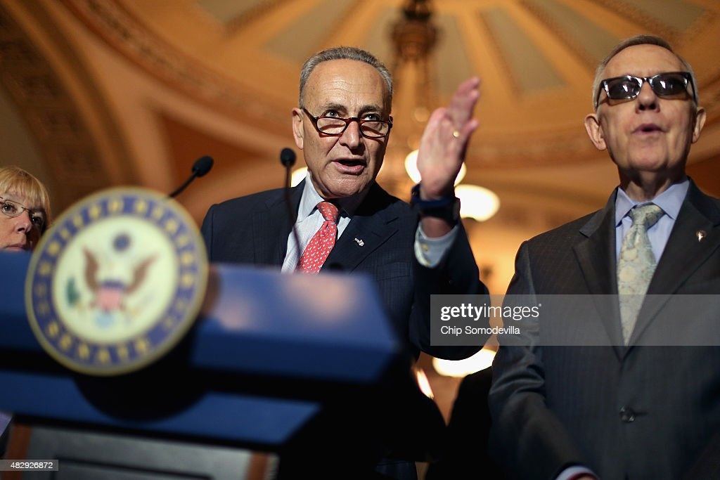 Sen. Charles Schumer (D-NY) (L) and Senate Minority Leader Harry Reid (D-NV) talk with reporters after the weekly Democratic policy luncheon at the U.S. Capitol August 4, 2015 in Washington, DC. Reid said there would be enough support to move a cybersecurity bill forward if Democrats were able to offer relevant amendments.