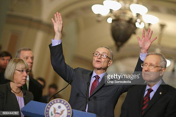 Sen Charles Schumer answers reporters' questions duirng a news conference with Sen Patty Murray Senate Minority Whip Richard Durbin and Senate...