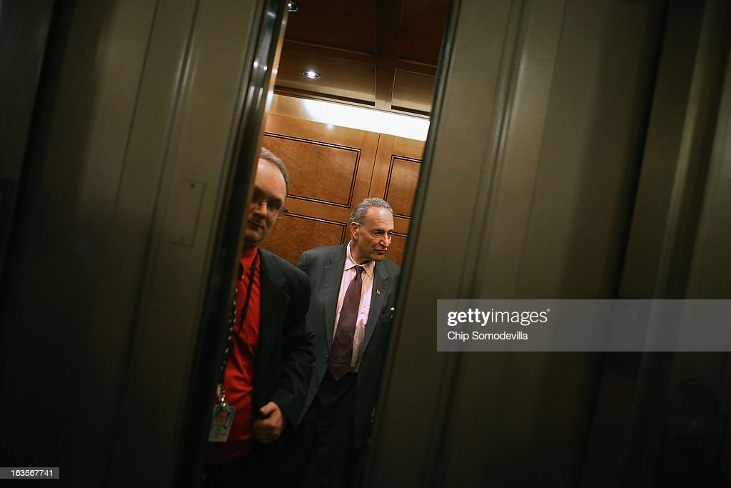 Sen. <a gi-track='captionPersonalityLinkClicked' href=/galleries/search?phrase=Charles+Schumer&family=editorial&specificpeople=171249 ng-click='$event.stopPropagation()'>Charles Schumer</a> (D-NY) (R) boards an elevator after he and fellow Senate Democrats met with U.S. President Barack Obama in the Mansfield Room at the U.S. Capitol March 12, 2013 in Washington, DC. With tax reform, spending cuts, gun control and immigration on the agenda, Obama will be holding four meetings over three days this week with Republican and Democratic members of Congress at the U.S. Capitol.