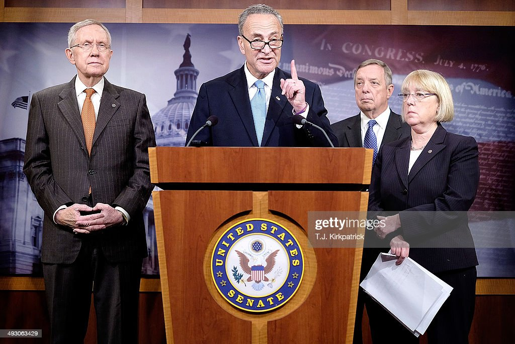 Sen. <a gi-track='captionPersonalityLinkClicked' href=/galleries/search?phrase=Charles+Schumer&family=editorial&specificpeople=171249 ng-click='$event.stopPropagation()'>Charles Schumer</a> (D-NY), center, with Sen. <a gi-track='captionPersonalityLinkClicked' href=/galleries/search?phrase=Harry+Reid+-+Politician&family=editorial&specificpeople=203136 ng-click='$event.stopPropagation()'>Harry Reid</a> (D-NV), left, Sen. <a gi-track='captionPersonalityLinkClicked' href=/galleries/search?phrase=Patty+Murray&family=editorial&specificpeople=532963 ng-click='$event.stopPropagation()'>Patty Murray</a> (D-NV), from right, and Sen. Richard Durbin (D-IL) hold a press conference to urge the House to enact immigration reform at the U.S. Capitol on May 22, 2014 in Washington, DC. Senate democrats called out House Speaker John Boehner for letting nearly a year pass without taking action since the Senate sent over a bipartisan comprehensive immigration reform bill.